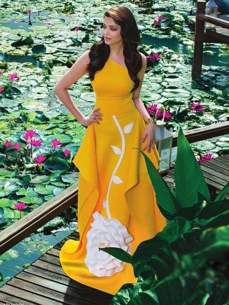 Aishwarya Rai in a bright yellow gown with floral appliqué. |  FemaleAdda.com